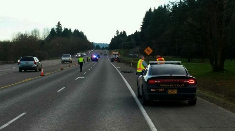 OSP PHOTO VIA KOIN 6 NEWS - Oregon State Police troopers respond to the scene of a fatal crash involving a cyclist and a truck driver on Jan. 12.