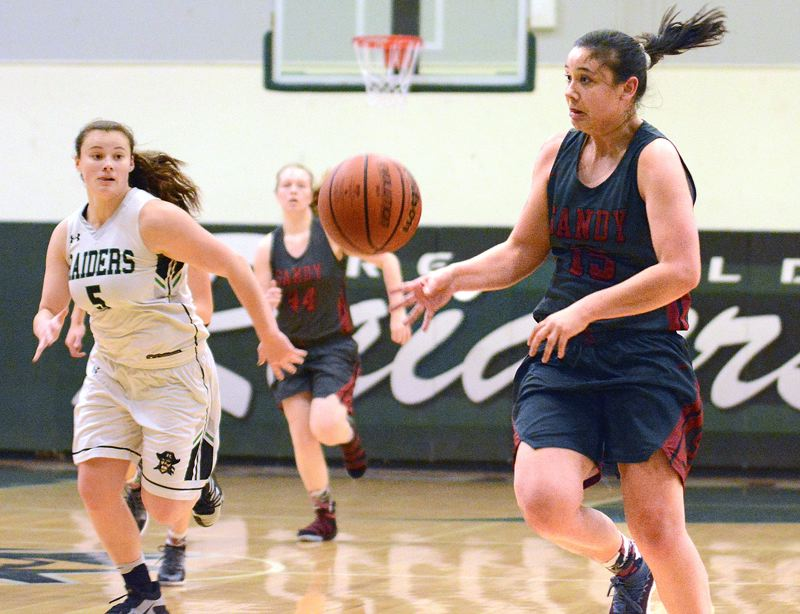 OUTLOOK PHOTO: DAVID BALL - Sandy's Izzy Cabrera looks to catch up to a pass on a fastbreak during her team's Friday win over Reynolds at Reynolds High School o Friday night.