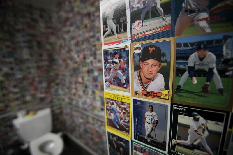 TRIBUNE PHOTO: JAIME VALDEZ - Major League Baseball players cards decorate the bathroom walls at the MLB-to-PDX pop-up shop in Portland.