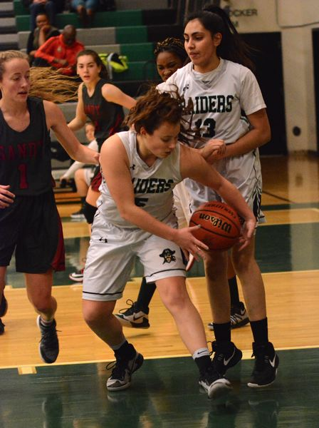 OUTLOOK PHOTO: DAVID BALL - Reynolds' Christina Chernoff pulls in a rebound during the team's 47-28 home loss to Sandy.