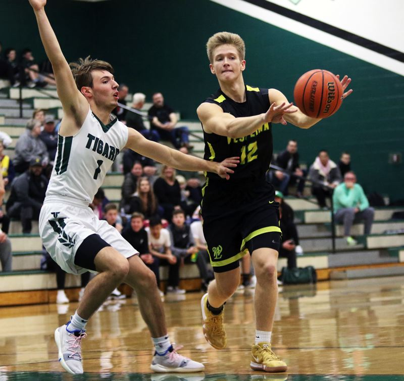 TIMES PHOTO: DAN BROOD - West Linn junior Parker Durbin (right), with Tigard senior Diego Lopez to his right, throws a pass during Friday's game at Tigard.
