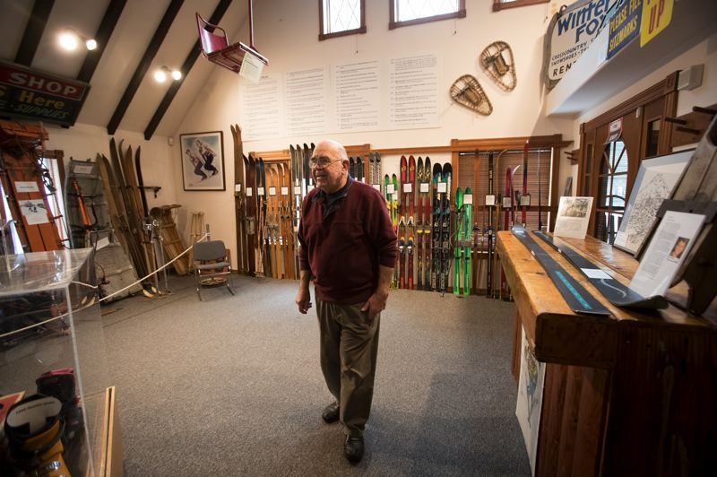 PAMPLIN MEDIA GROUP: JAIME VALDEZ  - Historian Lloyd Musser, the museums curator and past-president of its board of directors, shows off a roomful of historic ski equipment at the Mt. Hood Cultural Center and Museum.
