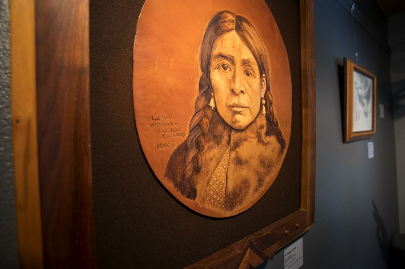 PAMPLIN MEDIA GROUP: JAIME VALDEZ - R. Foggia Jones' leather portrait of an Lummi woman on San Juan Islands, made using a hot wire as a tool, is one of hundreds of works by local artists on display and in storage at the Mt. Hood Cultural Center and Museum.