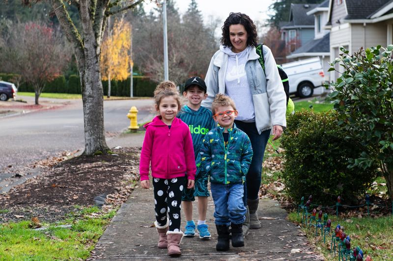 PAMPLIN MEDIA GROUP: CHISTOPHER OERTELL  - Stephanie Shimp-Taylor walks her son, Westen, 6, (middle) along with siblings Sawyer, 4 (left) and Daxton, 3, home from Patterson Elementary School in Hillsboro, where Westen suffered a concussion last fall.