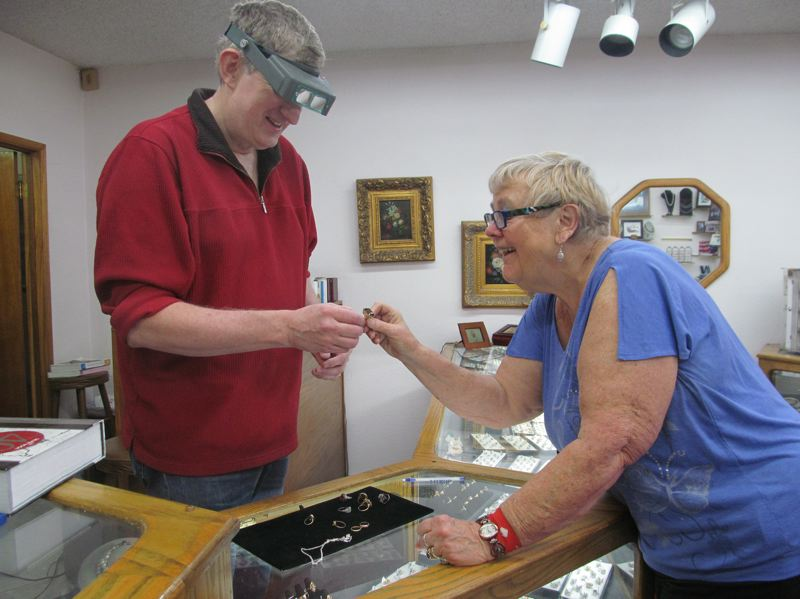 PHOTO BY ELLEN SPITALERI - Robert Nisbett explains what he can do to replace a stone in Sherrie Campbell's ring; she is a longtime customer and former Ardenwald resident.