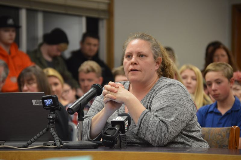 SPOTLIGHT PHOTO: NICOLE THILL-PACHECO - Parent Nicole Bainbridge speaks during a Scappoose School District school board meeting board room which was packed Monday, Jan. 14, when the school board discussed removing a book called 'George' from its Oregon Battle of the Books competiton list. Bainbridge spoke in favor of the resolution. The school board ultimately failed to pass the resolution, however, and schools will continue to particpate in the program which started competitions this week.