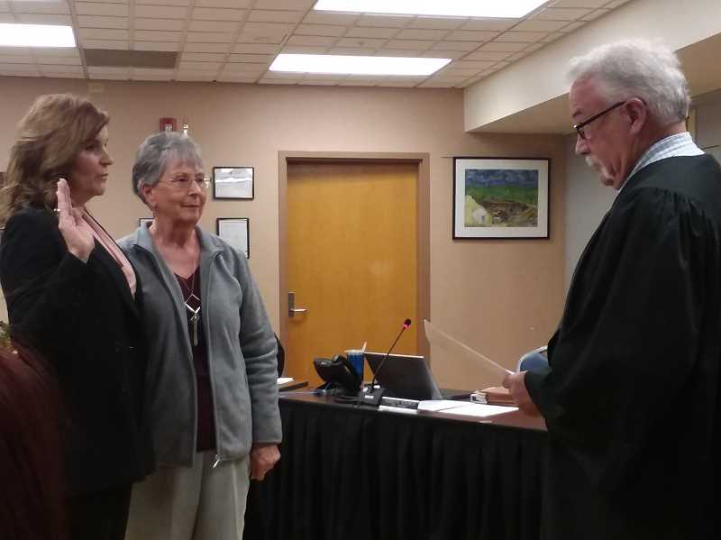 TIMES PHOTO: RAY PITZ - Tualatin City Councilor Nancy Grimes, left, is sworn in by Municipal Judge Jack Morris Monday night.