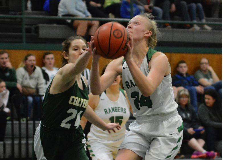 ESTACADA NEWS: DAVID BALL - Estacadas Izzy Hagel makes a move to the basket on a second-quarter drive during the Rangers 50-30 loss to Colton on Monday.