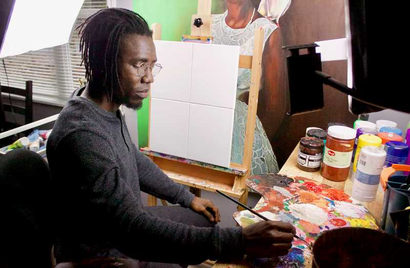OUTLOOK PHOTO: CHRISTOPHER KEIZUR - Otis Kwame Kye Quaicoe moved his studio, usually in the garage of his Gresham home, into the kitchen for the winter.