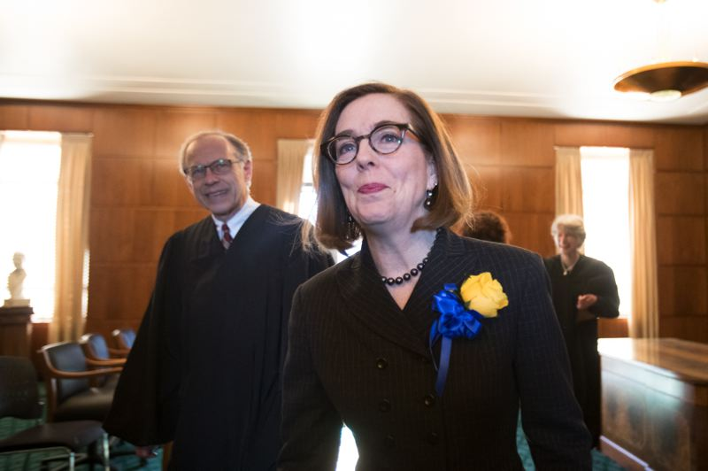 PAMPLIN MEDIA GROUP: JAIME VALDEZ - Gov. Kate Brown told lawmakers Monday, Jan. 14, that they needed to help solve Oregon's most pressing problems. Brown was inaugurated for her second term during a Capitol ceremony.