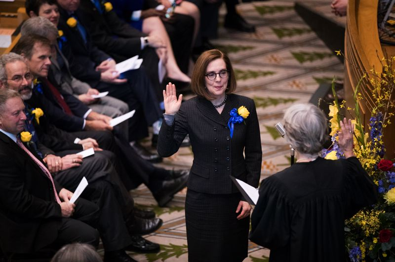 PAMPLIN MEDIA GROUP: JAIME VALDEZ - Oregon Supreme Court Chief Justice Martha L. Walters administered the oath of office Monday, Jan. 14, to Gov. Kate Brown during a ceremony at the state Capitol.