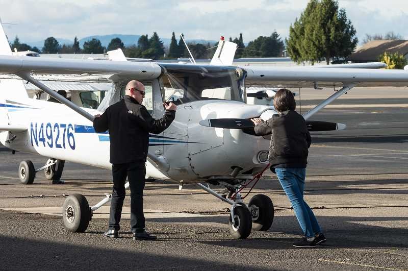 STAFF PHOTO: CHRISTOPHER OERTELL - Pilots prepare a plane for takeoff at Hillsboro Aero Academy last year. The flight school can't award students pilots licenses without approval from Federal Aviation Administration officials, who are furloughed.
