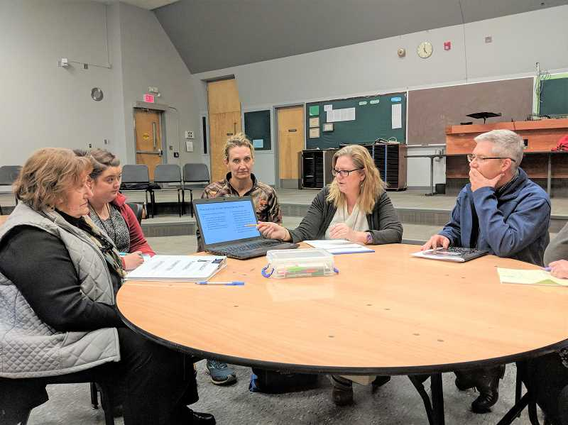 ESTACADA NEWS PHOTO: EMILY LINDSTRAND - During a meeting on Tuesday, Jan. 8, members of the Estacada School Districts calendar committee discuss pros and cons of implementing a later school start time.