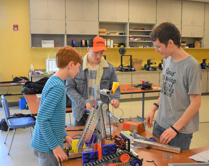 ESTACADA NEWS PHOTO: EMILY LINDSTRAND - Students in Summit Learning Charter's FIRST Tech Challenge team work on a robot that will compete in an upcoming tournament.