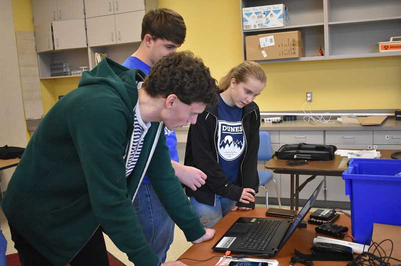 ESTACADA NEWS PHOTO: EMILY LINDSTRAND - Members of Summit Learning Charter's FIRST Tech Challenge team study their robot as they prepare for an upcoming tournament.