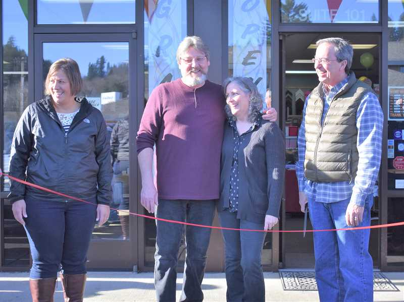 ESTACADA NEWS PHOTO: EMILY LINDSTRAND - Michele Jones, Dave Anderson, Ellen Anderon and Brent Dodrill smile prior to the ribbon cutting for The Artsmith on Saturday, Jan. 12.