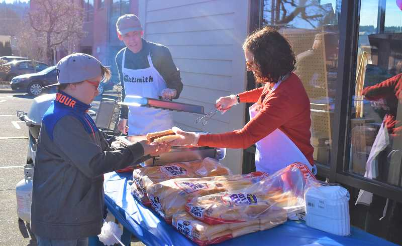 ESTACADA NEWS PHOTO: EMILY LINDSTRAND - Community members enjoyed free hot dogs during the grand opening celebration for The Artsmith last weekend.