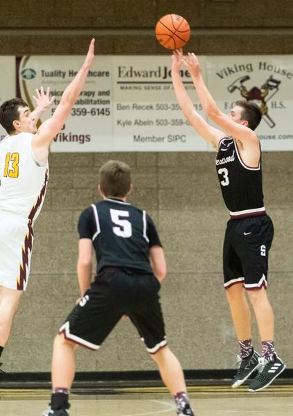 PMG PHOTO: CHRISTOPHER OERTELL - Sherwood High School senior Tyler Hix (right) takes a jump shot during the Bowmens win at Forest Grove on Friday.