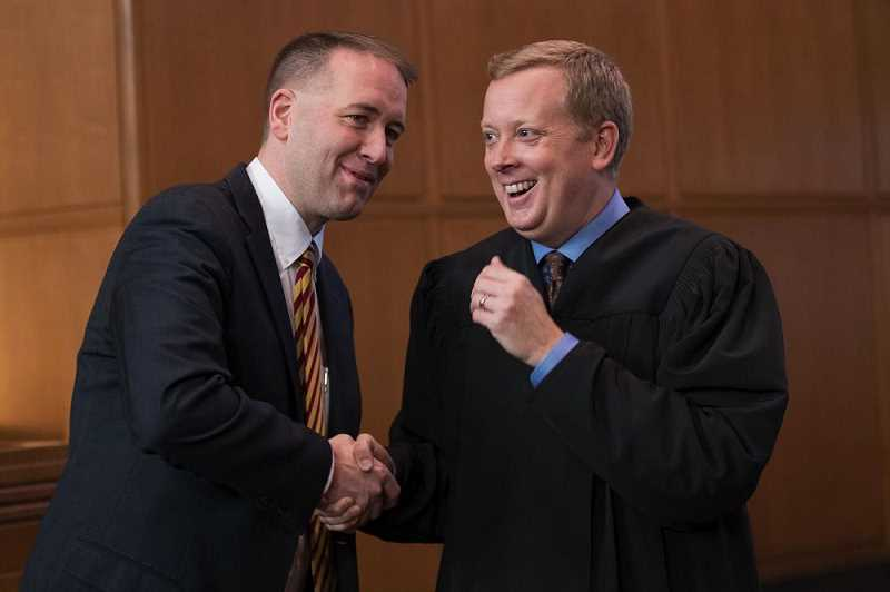 Former State Representative Chris Garrett now sits on the Oregon Supreme Court.  Shown here after swearing in Oregon State Treasurer Tobias Read in 2017.