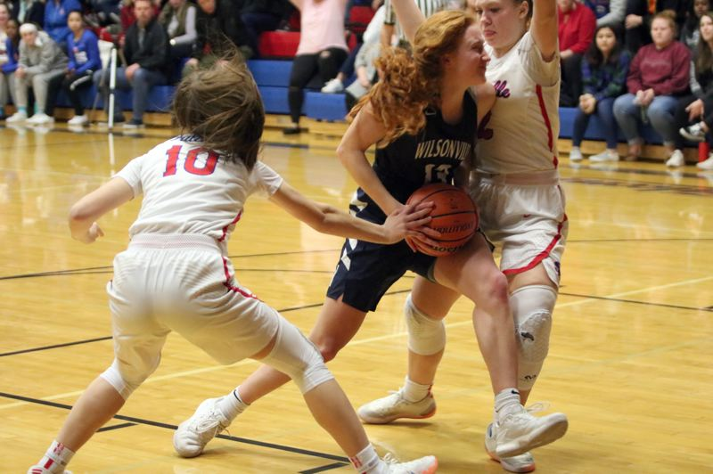PAMPLIN MEDIA: JIM BESEDA - Wilsonville's Syndey Burns (13) runs into La Salle Prep's Emily Niebergall (right) as the Falcons' Amanda Sisul (10) reaches for the ball during Tuesday's NWOC girls' basketball game at La Salle.