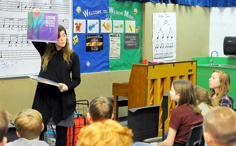 GARY ALLEN - Kim Harrison, director of education for PDX Jazz, explains vinyl records to a group of students at Mountain View Middle School on Jan. 10.