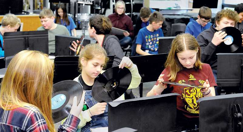 GARY ALLEN - Mountain View Middle School students check out the classic vinyl records provided by PDX Jazz during a talk Jan. 10.