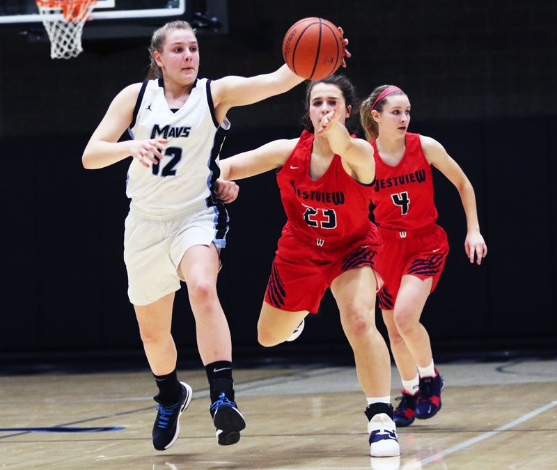TIMES PHOTO: DAN BROOD - Mountainside freshman Lindsay Wilson (left) reaches for the ball in front of Westview sophomore Afton Keeney during Tuesdays game.