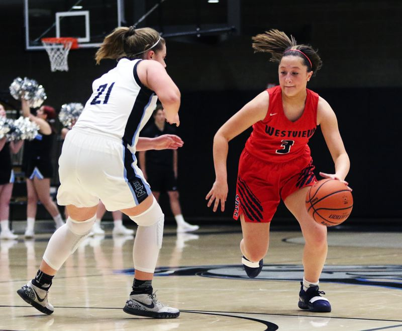 TIMES PHOTO: DAN BROOD - Westview sophomore Josie Napoli (right) brings the ball up court against Mountainside freshman Taylor Smith during Tuesday's game.