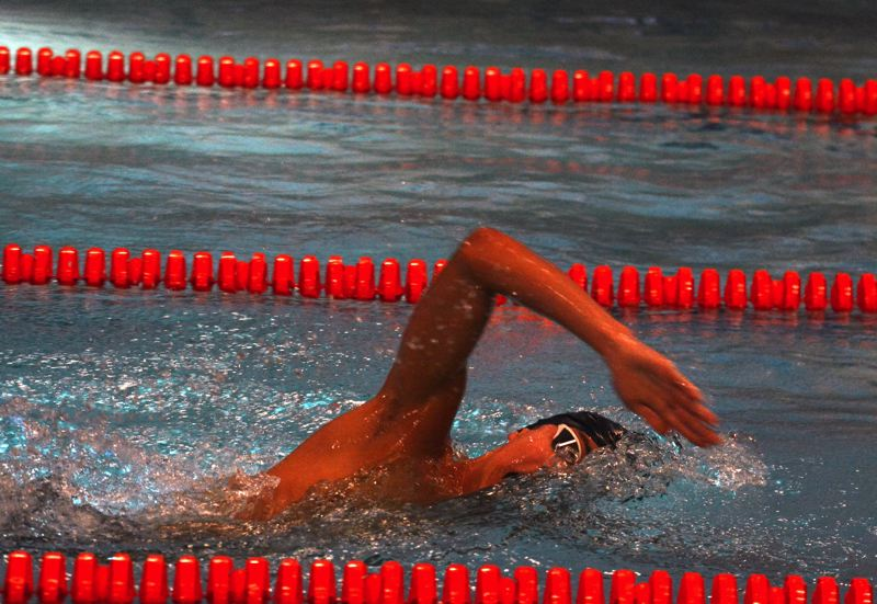 TIMES PHOTO: MATT SINGLEDECKER - Beaverton senior Justin Zhou took first place overall in the 100-yard freestyle against Jesuit last week.
