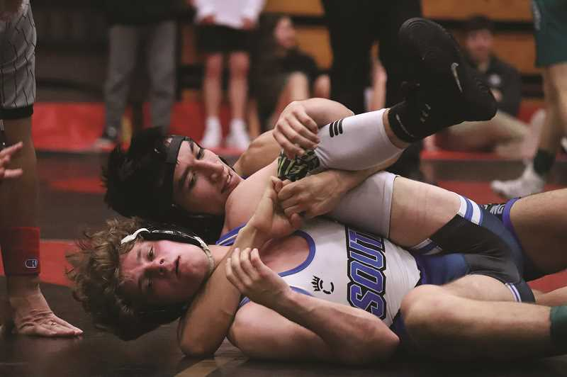 COURTESY: WOODBURN WRESTLING - Hector Paniagua won the 126-pound bracket over South Medfords Isaac Rubus, one of eight Woodburn wrestlers to place at the Southridge Invitational on Saturday.