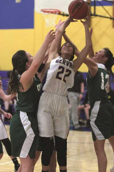 PHIL HAWKINS - Gervais junior Bella Vasquez gets fouled under the hoop against Colton. Vasquez scored a team-best 13 points, including 7-of-8 free throws, in the Cougars 43-42 loss to the Vikings on Jan. 9.