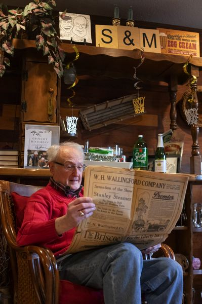 PORTLAND TRIBUNE: JONATHAN HOUSE - Stan Usher checks out  the 1919 Oregon Auto Show program in his living room.