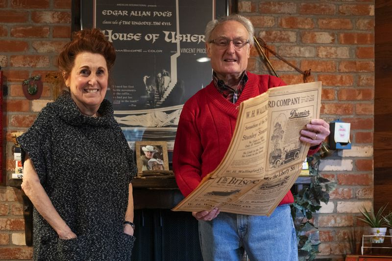 PORTLAND TRIBUNE: JONATHAN HOUSE - Maxine and Stan Usher with the 1919 Oregon Auto Show program in their living room.
