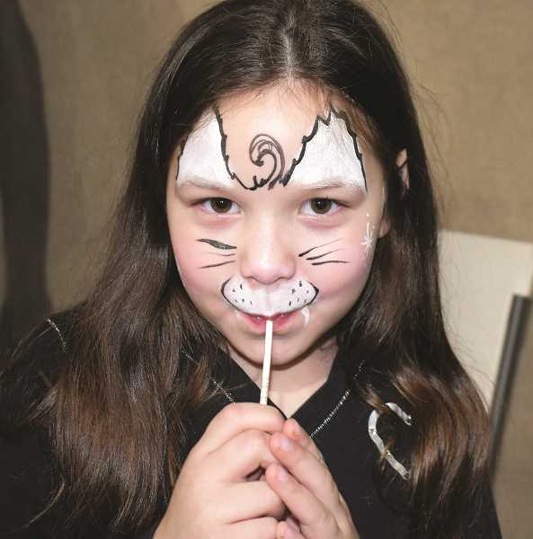 COURTESY: JUDY ADAMS - Face painting and sweets were among the carnival treats at Sacred Heart Catholic School in Gervais on Saturday.