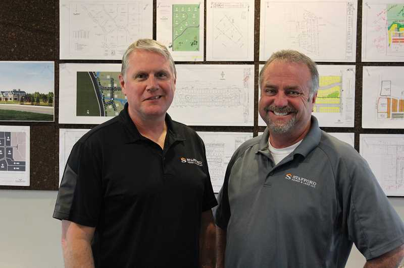 SPOKESMAN PHOTO: COREY BUCHANAN - Rick Waible and Gordon Root are principals at Stafford Homes and Land.