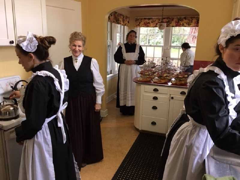 PHOTO: WEST LINN HISTORICAL SOCIETY - West Linn Historical Society volunteers dressed as French maids preparing tea and treats.