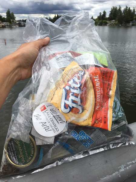 SUBMITTED PHOTO - A recent run through Lake Oswego yielded this plastics-filled bag of trash, Jenny Slepian says.