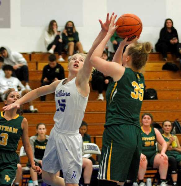 STAFF PHOTO: WADE EVANSON - Hillsboro's McKenzie Staub goes up to block a shot during the Spartans' game against Putnam, Tuesday, Jan. 15, at Hillsboro High School.