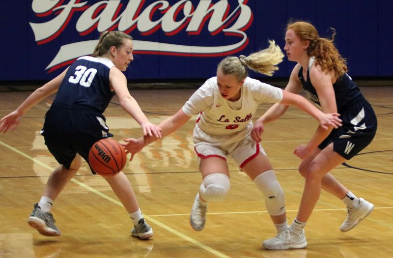 PAMPLIN MEDIA: JIM BESEDA - La Salle Prep's Emily Niebergall (middle) loses control of the ball under pressure from Wilsonville's Kayla Hieb (30) and Sydney Burns in Tuesday's Northwest Oregon Conference game at La Salle.