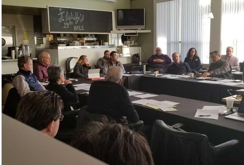 REVIEW PHOTO: GARY M. STEIN - Councilors, the mayor and City staff gather Saturday at the Lake Oswego Public Golf Course for their annual daylong retreat devoted to establishing a list of goals for the new year.