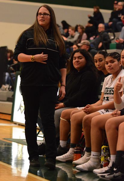 OUTLOOK PHOTO: DAVID BALL - Reynolds coach Kelsey Stone paces the sideline. The Raiders beat Centennial 44-41 for their first league win since 2017.