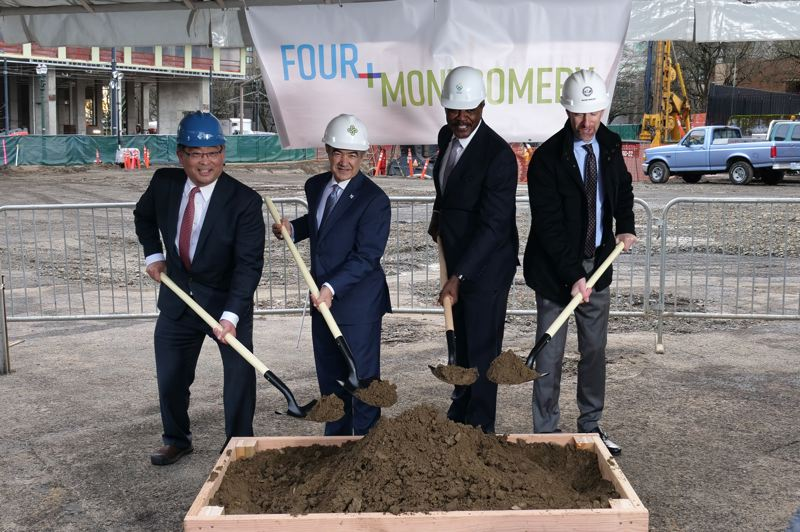 COURTESY: PORTLAND STATE UNIVERSITY - Mark Mitsui, from left, president of Portland Community College; Rahmat Shoureshi, president of Portland State University; Danny Jacobs, president of Oregon Health and Science University; and Portland Mayor Ted Wheeler dig in during a Jan. 11 groundbreaking ceremony to kick off construction of the Fourth and Montgomery project.