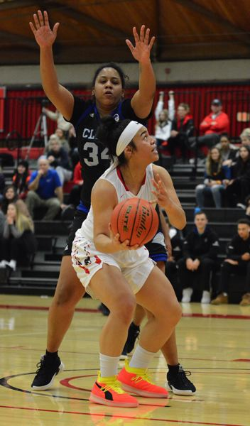 OUTLOOK PHOTO: DAVID BALL - Mt. Hoods Atalina Pritchard looks for a path to the basket against Clark center Mahrysa Thomas.