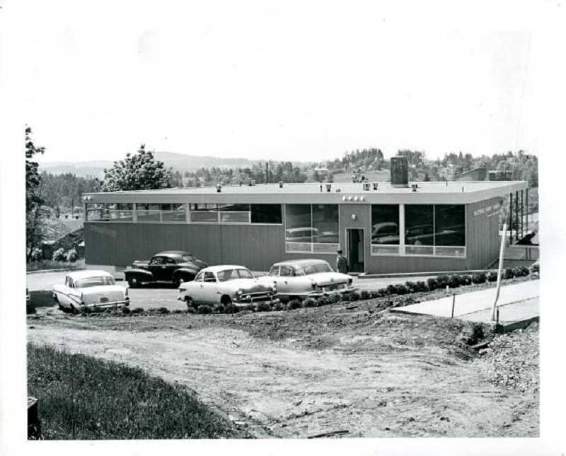COURTESY OF MULTNOMAH COUNTY LIBRARY - This photo was taken  not long after construction of what was then the Southwest Hills branch of the Multnomah County Library in 1957.  This shows the back of the library where staff can be seen entering.