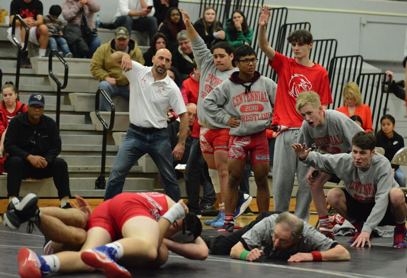 OUTLOOK PHOTO: DAVID BALL - Centennial teammates prepare to celebrate as Bailey Sparks zeroes in on a pin at 170 pounds.