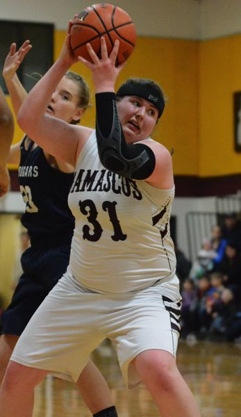 OUTLOOK PHOTO: DAVID BALL - Damascus Christians Tory Webb turns to the basket for two of her game-high 14 points during the Eagles 38-34 win over Country Christian on Tuesday.