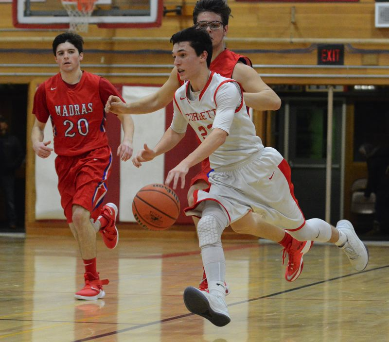OUTLOOK PHOTO: DAVID BALL - Corbetts Dylan Paintner rushes down the floor ahead of a pair of Madras defenders in Wednesday's 74-61 home loss.