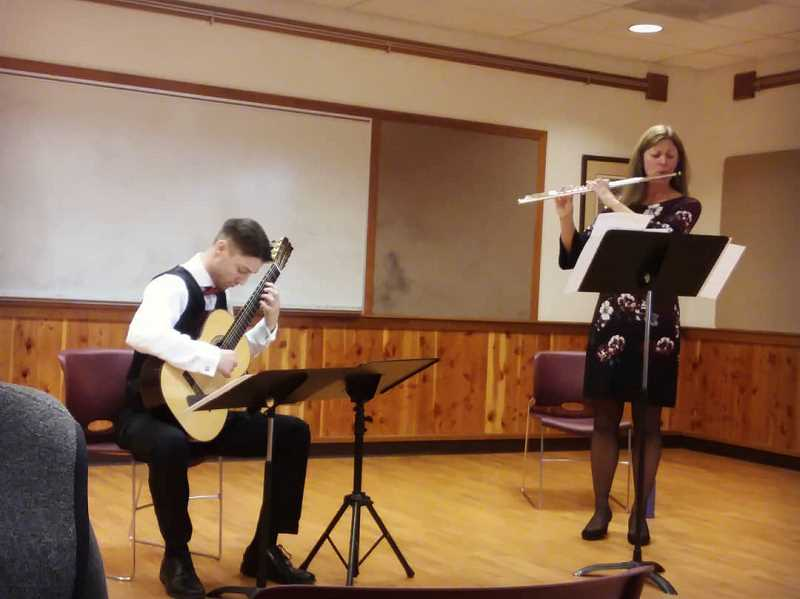 PHOTO COURTESY OF BRANDON AZBILL  - Brandon Azbill plays his classical guitar with Central Oregon Symphony flutist Stefanie Janin during a Nov. 3 Music in Public Places performance at the Crook County Library.