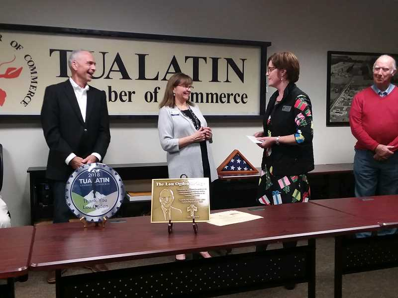 TIMES PHOTO: RAY PITZ - Lou Ogden is honored at a final Tualatin Chamber of Commerce event that included, from left, Chamber Director Linda Molholt, City Manager Sherilyn Lombos and Dale Potts, an active member of the local VFW.