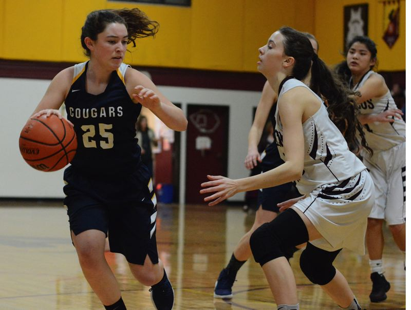 OUTLOOK PHOTO: DAVID BALL - Country Christians Allison Burruel dribbles down the right side looking for a lane to the basket during the Cougars 38-34 loss to Damascus Christian.
